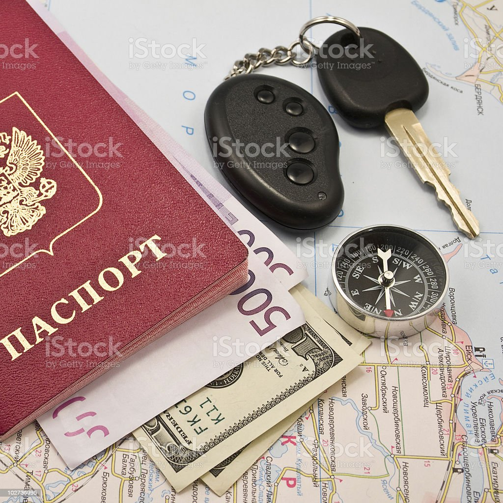 Passport  with  money and compass on a map royalty-free stock photo