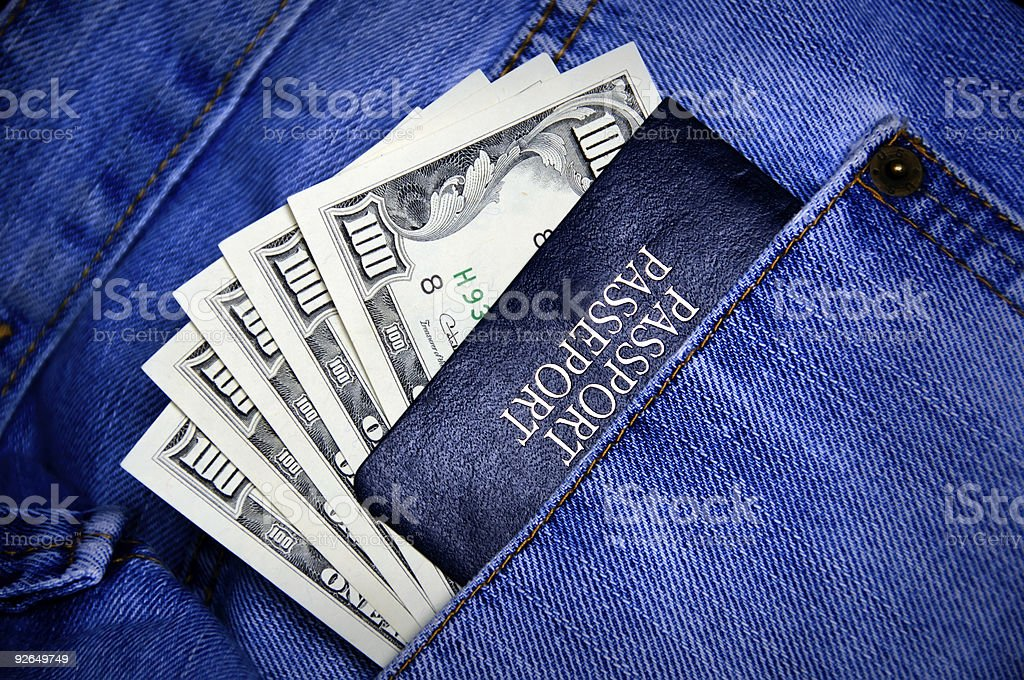 Passport with money in the pocket royalty-free stock photo
