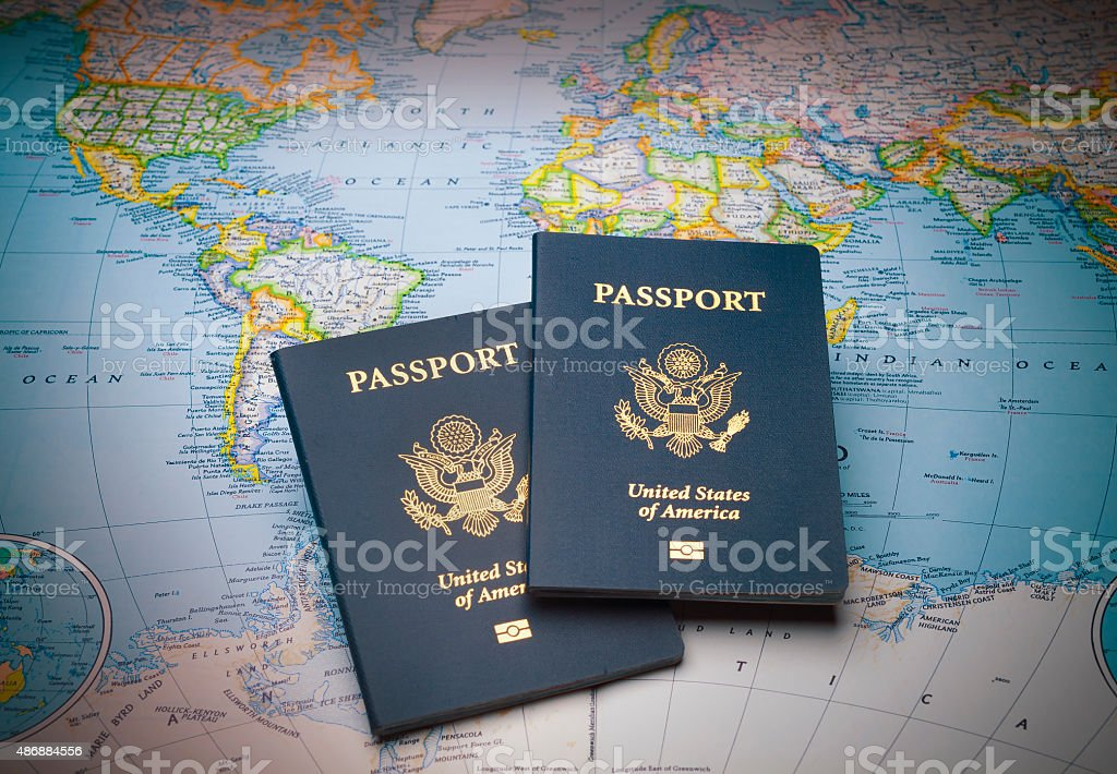 Passports on a map of the world stock photo