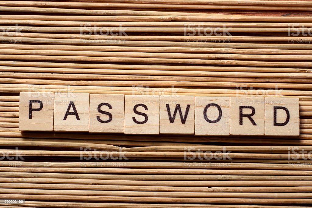 password word on wooden cube at wood background stock photo