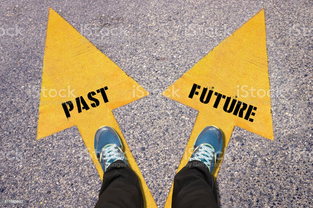 Past and Future painted on road stock photo
