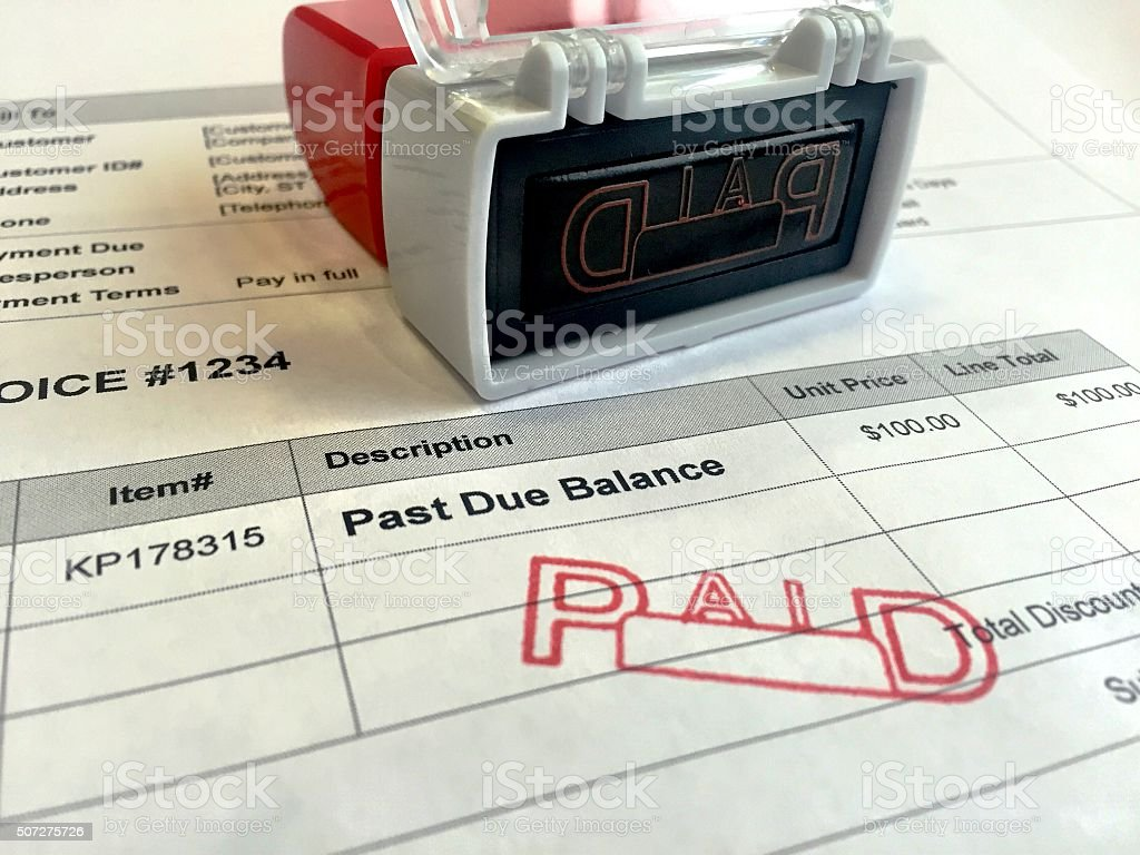 Past Due Invoice Paid Stamp stock photo