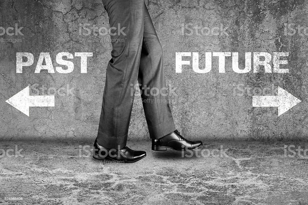 Past or Future way written text on dirty wall stock photo
