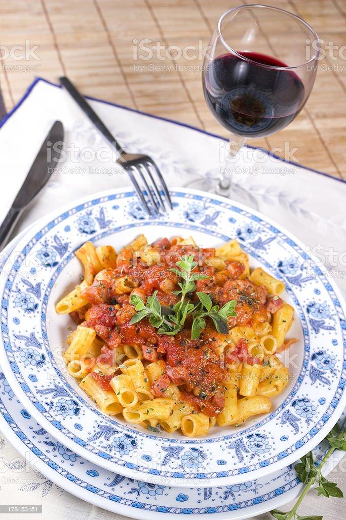 Pasta Amatriciana with red wine stock photo