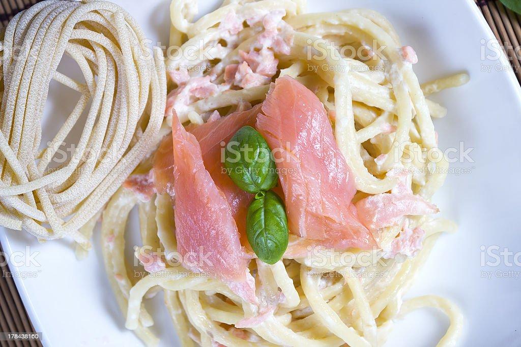 Pasta and salmon stock photo