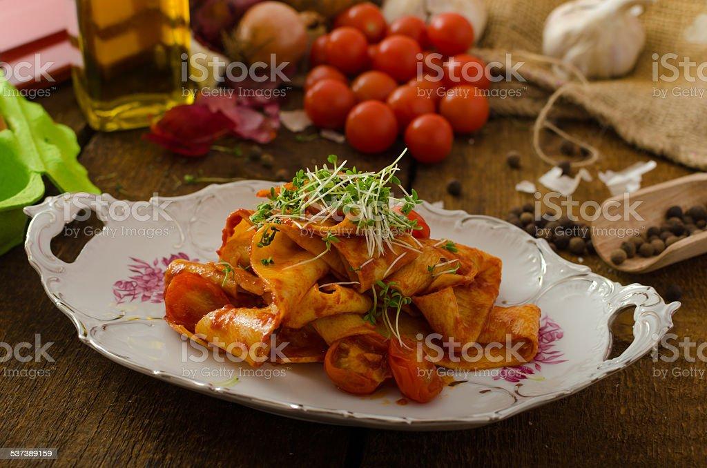 Pasta arrabiata with chilli and garlic organic stock photo