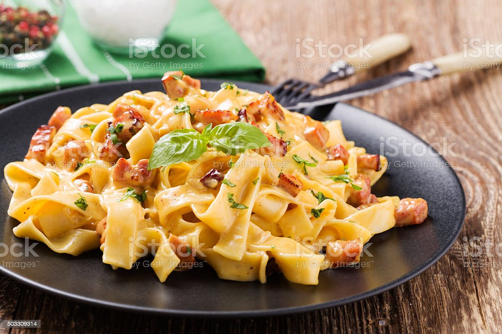 Pasta Carbonara with bacon, basil and cheese stock photo