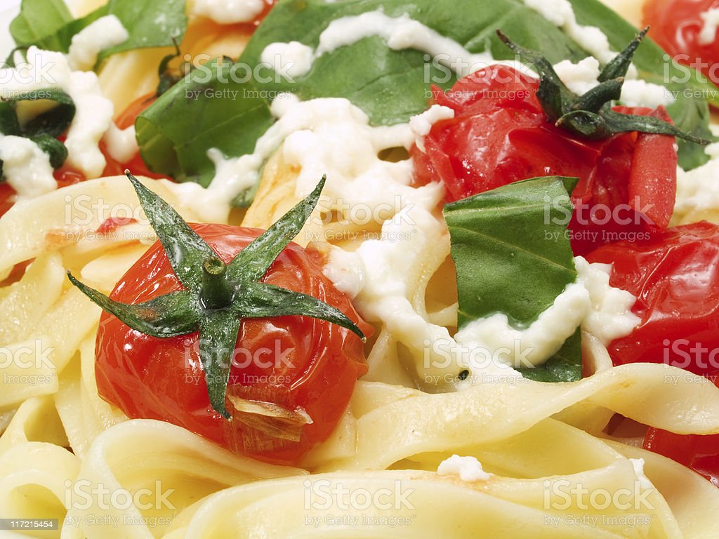 Pasta Collection - Fettucini with tomatoes, basil and mozarella royalty-free stock photo