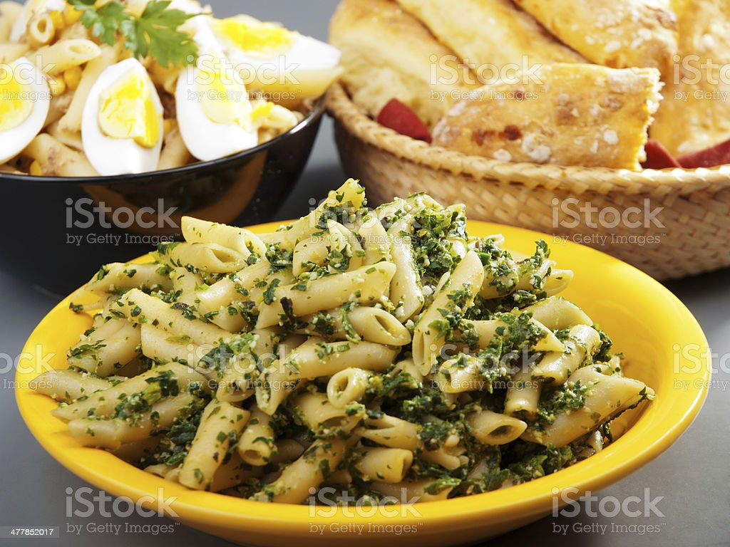 Pasta Collection - Penne with pesto stock photo