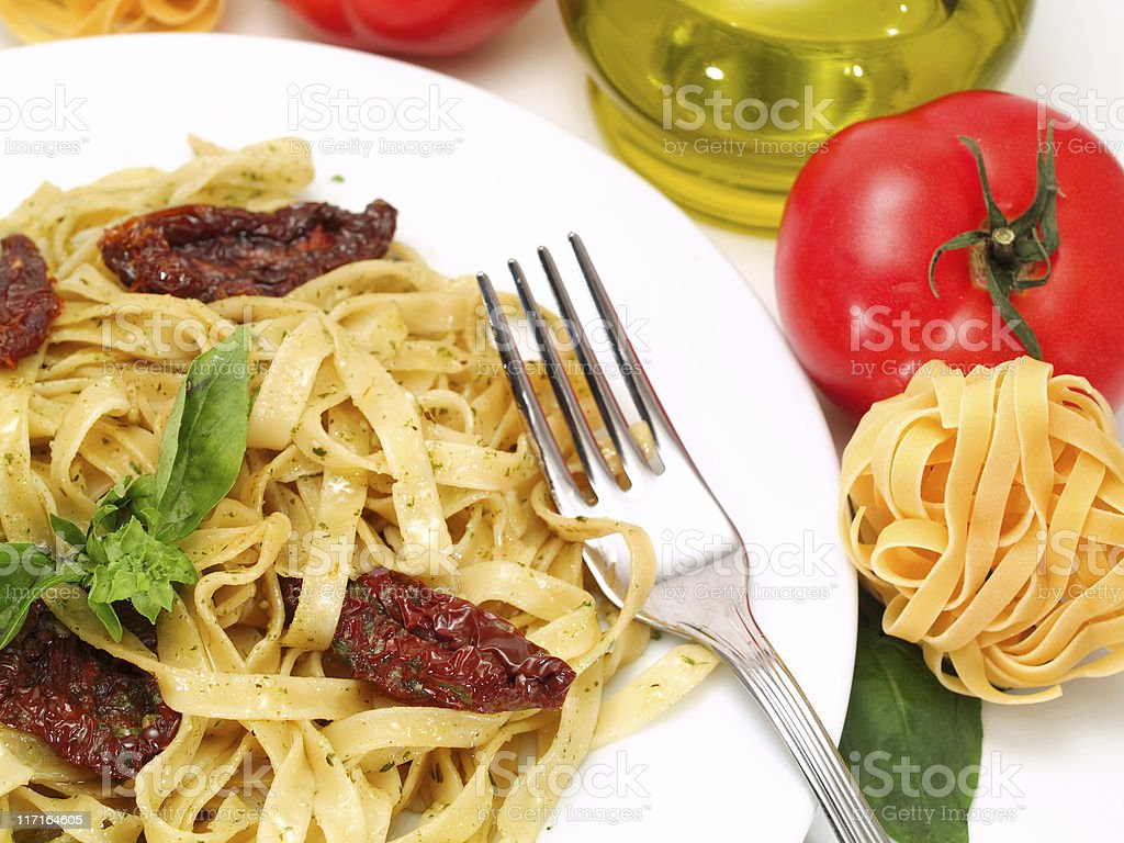 Pasta Collection - Tagliatelle with Salmon, Basil and Dried Tomatoes royalty-free stock photo