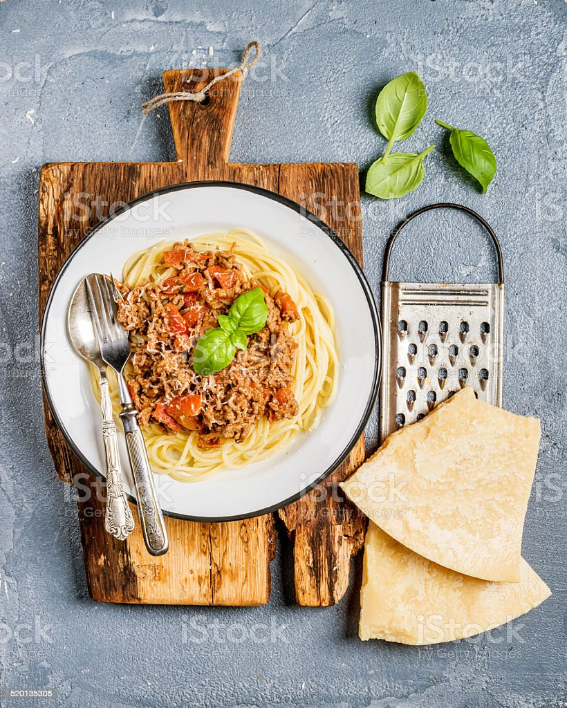 Pasta dinner. Spaghetti Bolognese in metal plate on rustic wooden stock photo