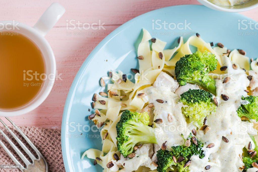 Pasta dish broccoli sauce sunflower seeds stock photo