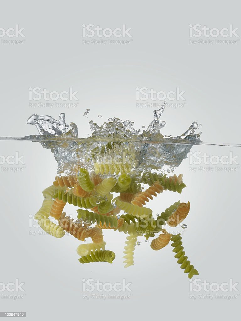 Pasta Falling In Water royalty-free stock photo