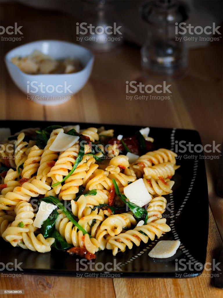 pasta fusilli with spinach stock photo
