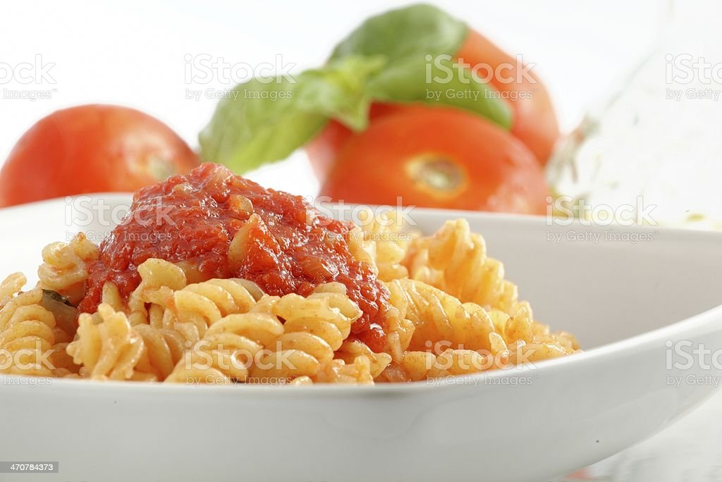 Pasta fusilli with tomato sauce stock photo