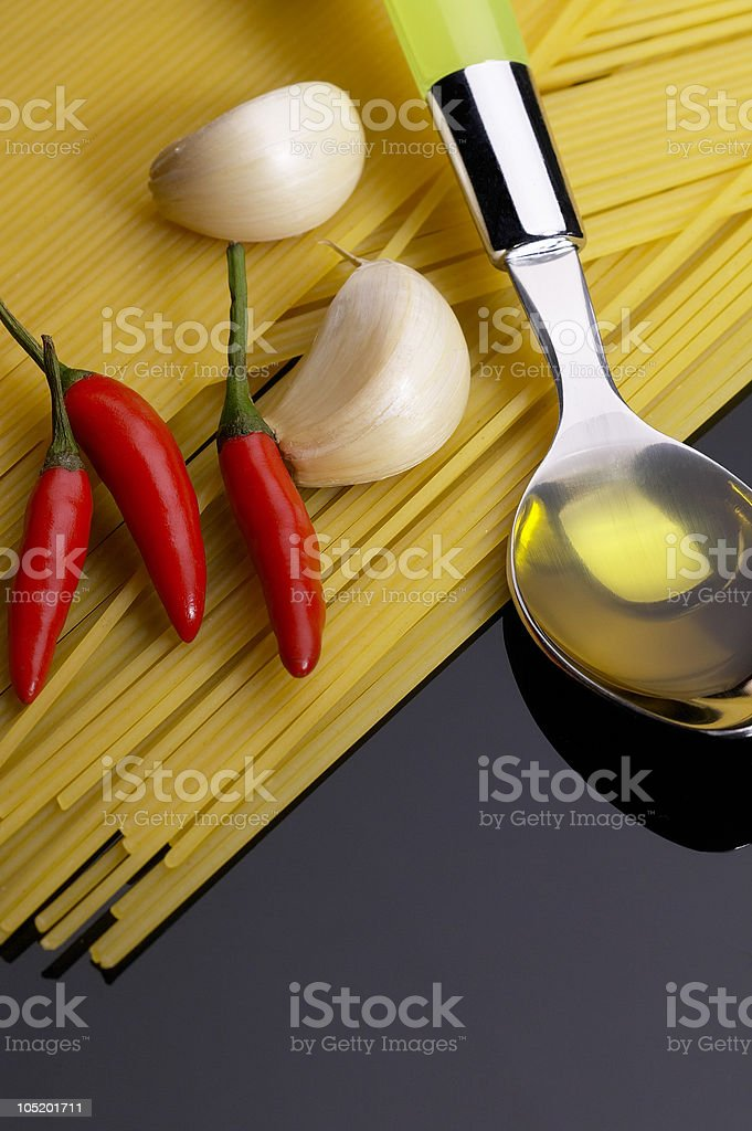 pasta garlic extra virgin olive oil and red chili pepper royalty-free stock photo