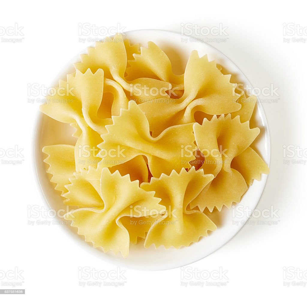 pasta in bowl isolated on white, from above stock photo