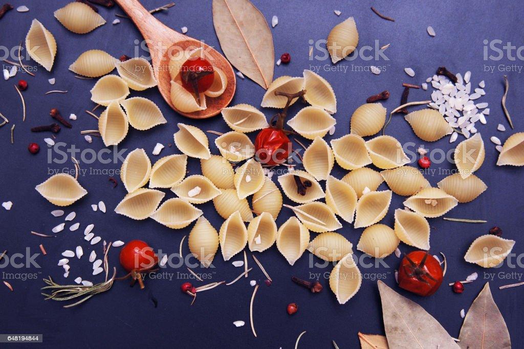 Pasta in wooden spoon stock photo