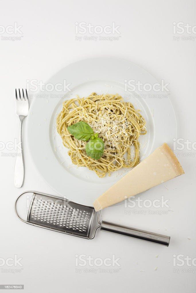 Pasta meal with pesto sauce, parmesan and basil stock photo