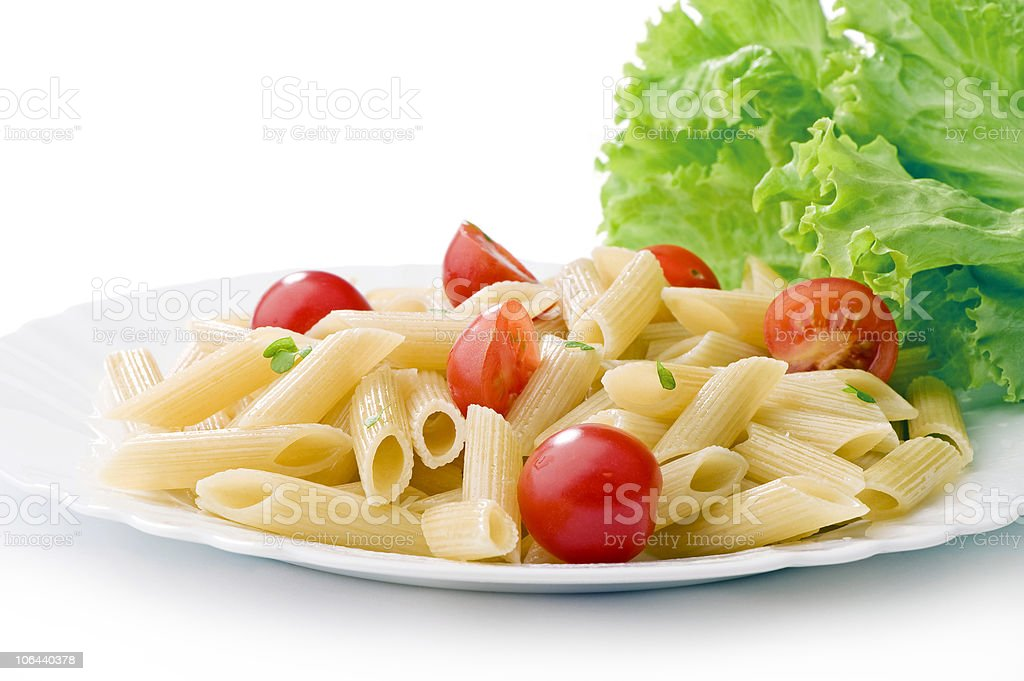 pasta on a white plate with cherry tomatoes royalty-free stock photo