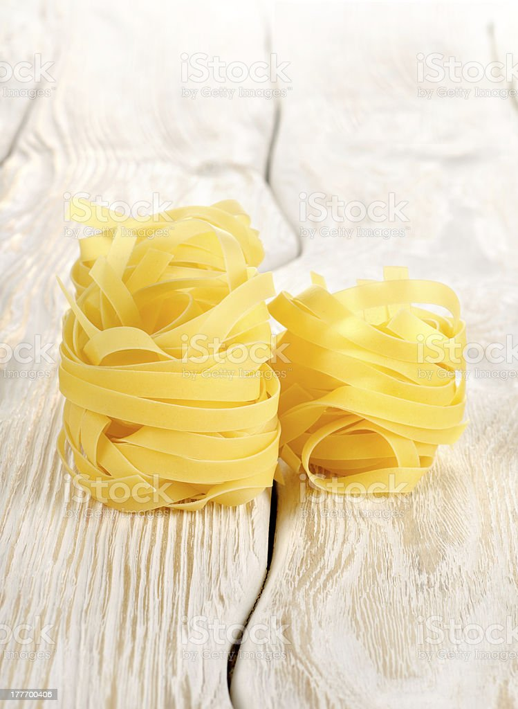 Pasta on a white table royalty-free stock photo