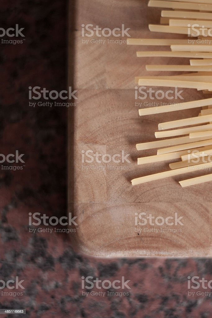 Pasta on chopping board royalty-free stock photo