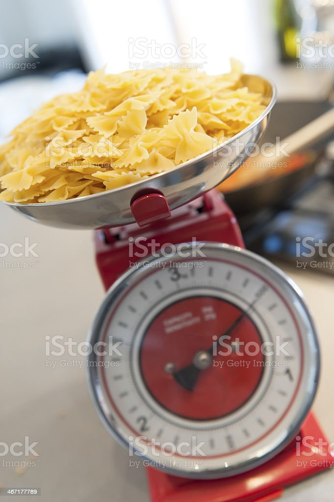 Pasta on the scale stock photo