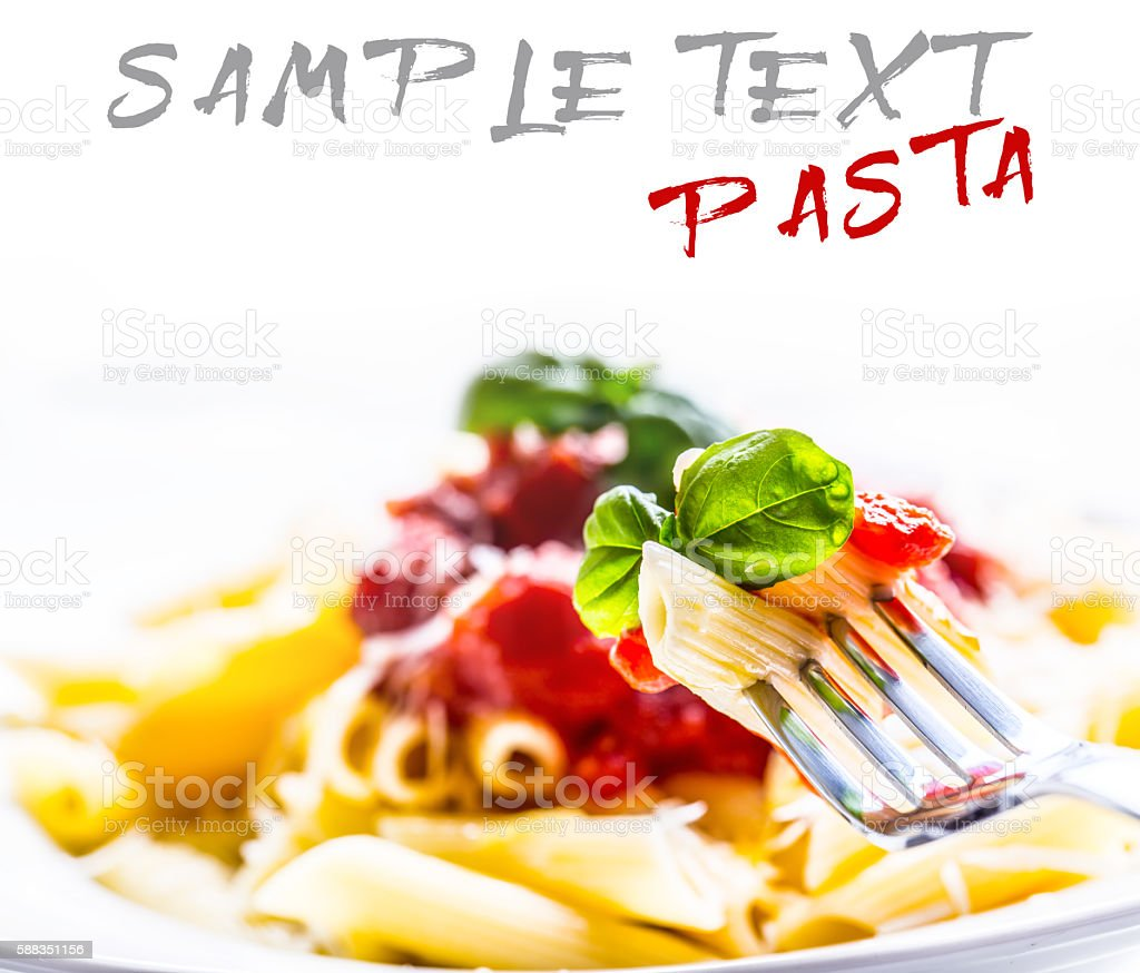 Pasta Penne with Tomato Bolognese Sauce, Parmesan Cheese and Basil stock photo