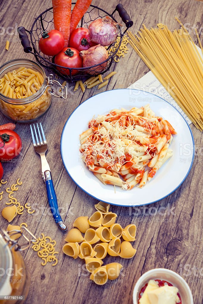 Pasta, raw and cooked stock photo