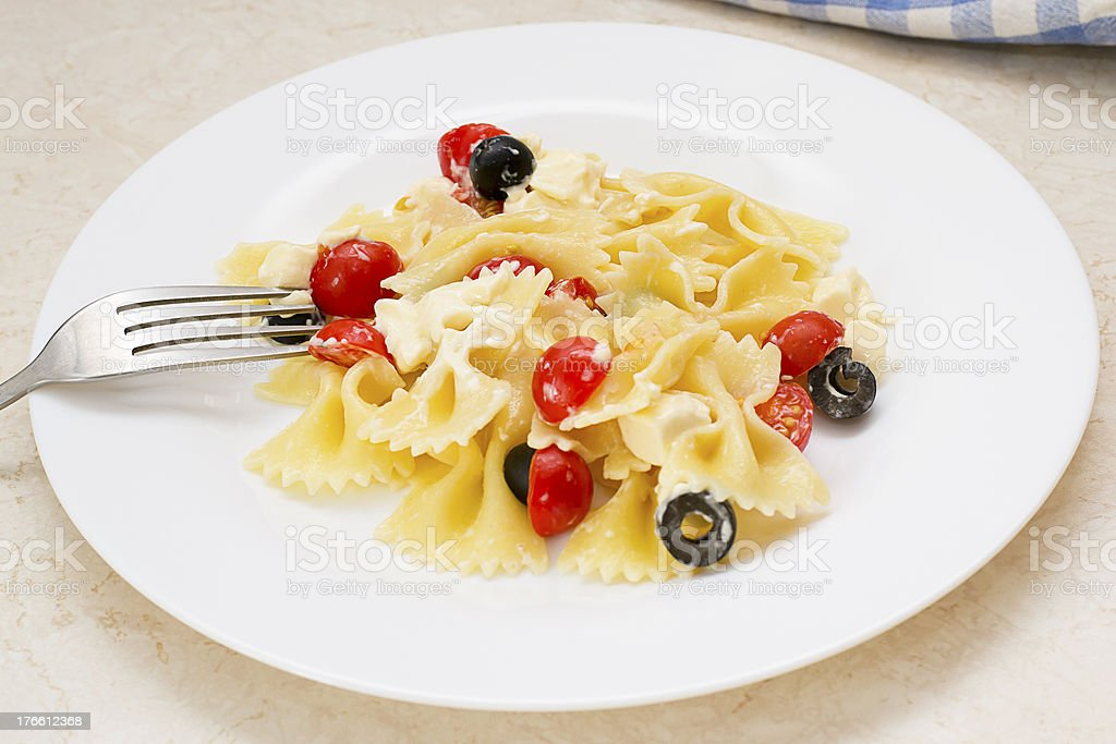 Pasta ribbons, cherry tomatoes and olives royalty-free stock photo