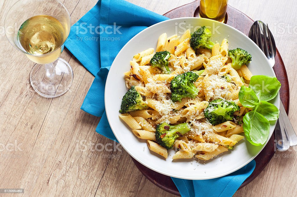 pasta salad with broccoli and Parmesan cheese.  white wine . stock photo