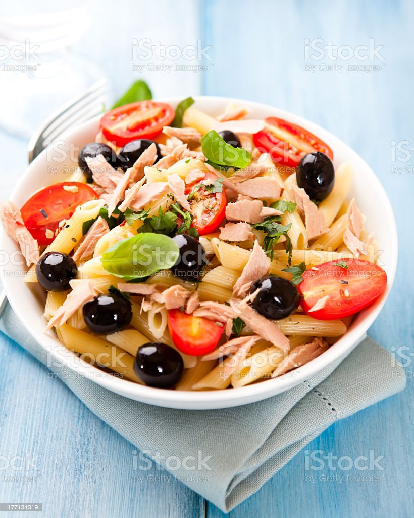 Pasta salad with tuna and olives stock photo