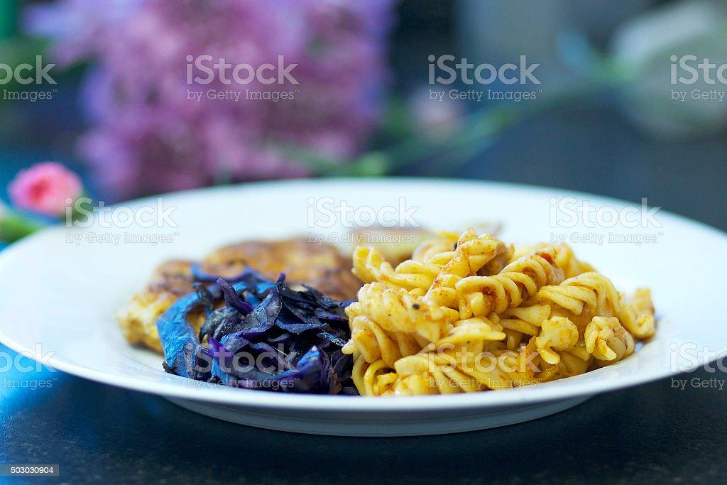 Pasta, Schnitzel and Purple Cabbage stock photo