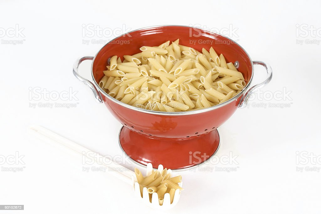 Pasta shells in colander royalty-free stock photo