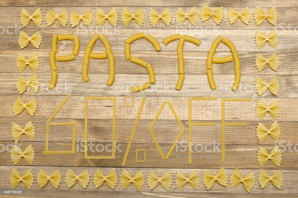 pasta  sixty percent off text made of raw pasta stock photo