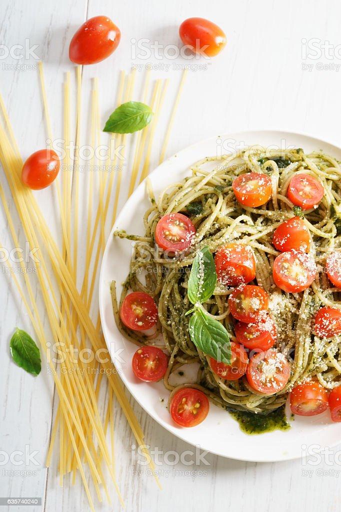 Pasta spaghetti with pesto sauce stock photo