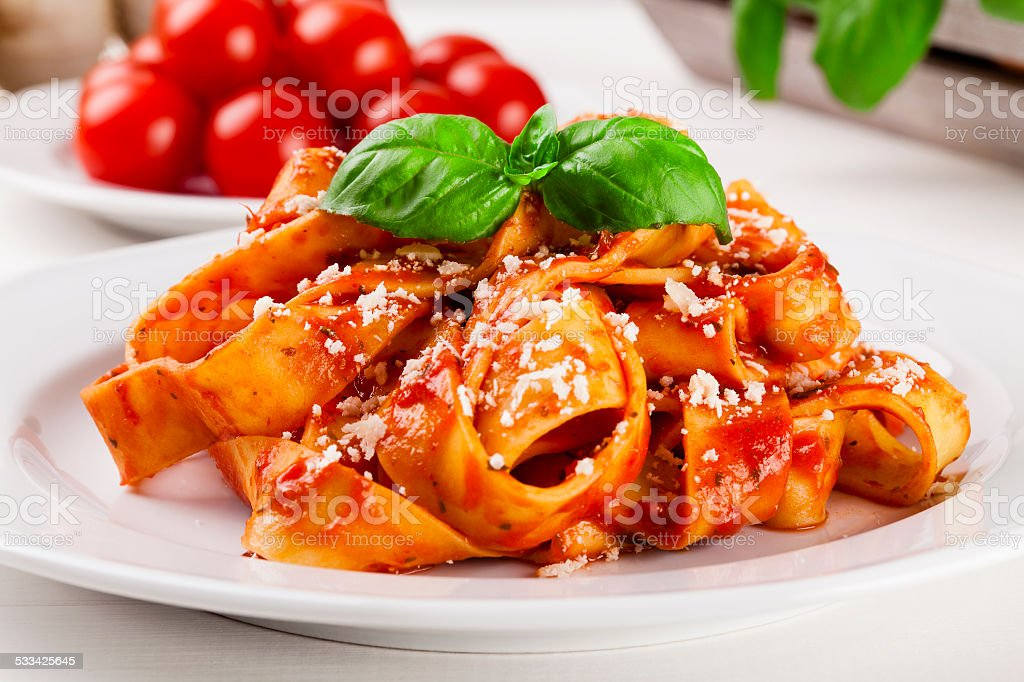 Pasta tagiatelle with tomato stock photo