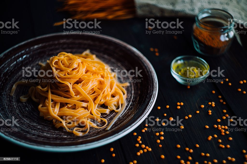 Pasta tagliatelle with seasonic on a wooden table stock photo