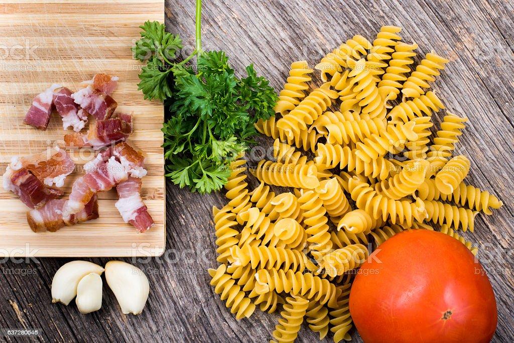 Pasta, tomato, smoked ham in natural light stock photo