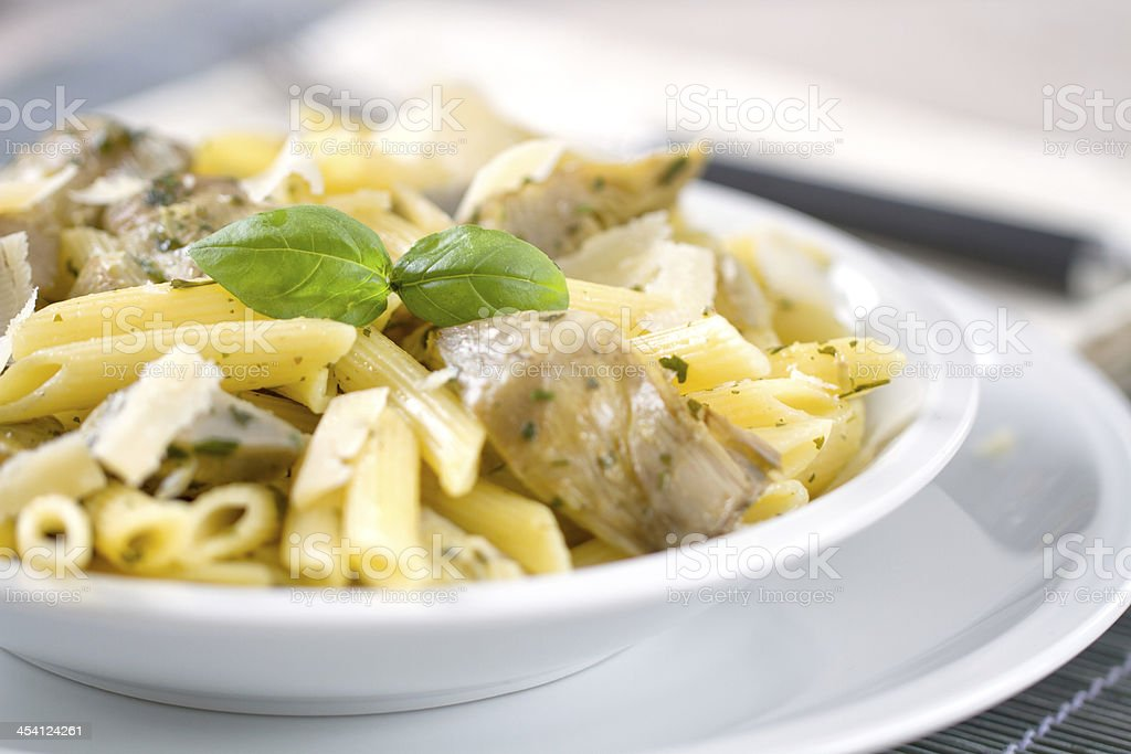 Pasta with artichokes royalty-free stock photo