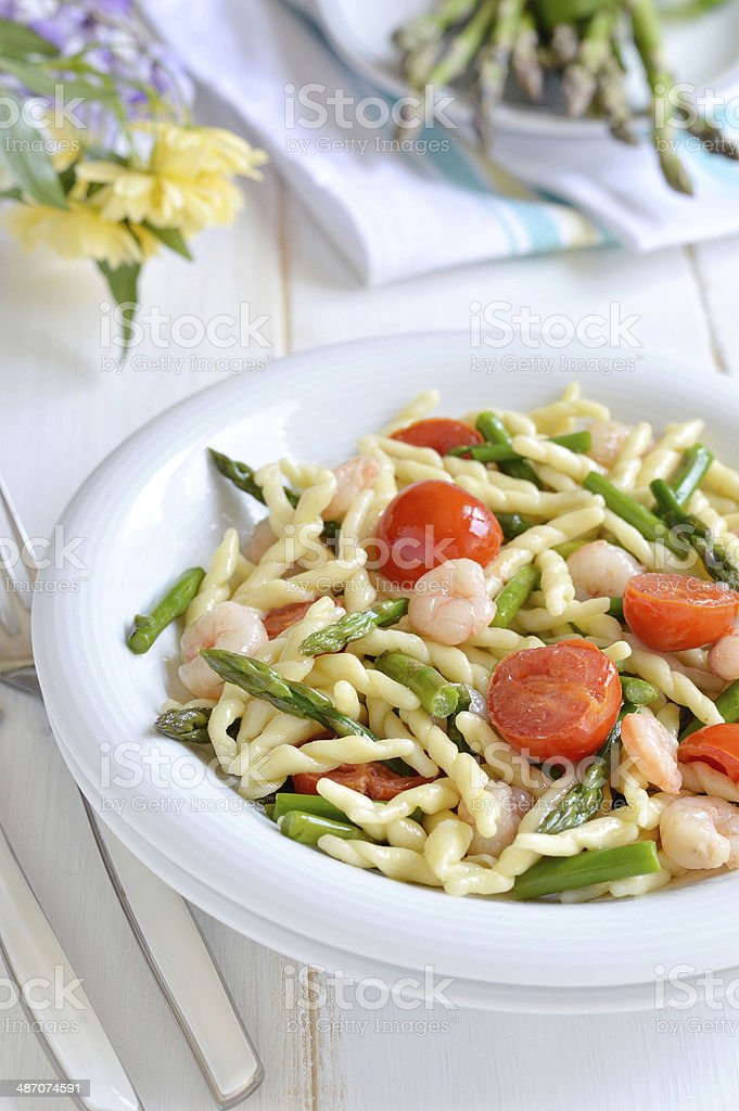 Pasta with asparagus and shrimp. Italian food. royalty-free stock photo