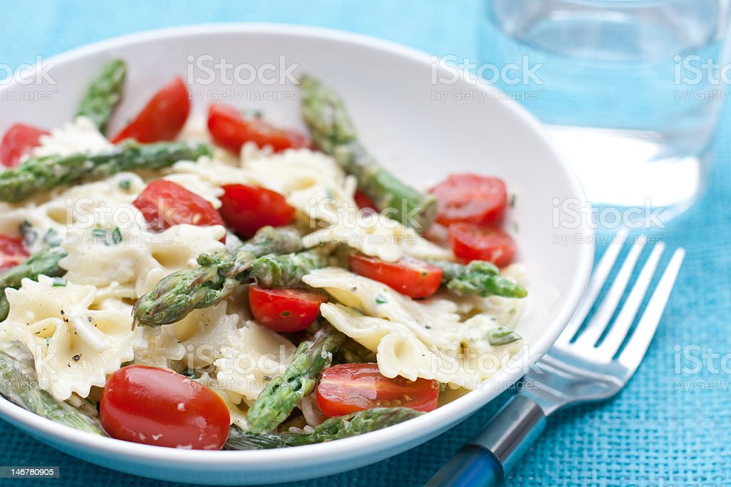 pasta with asparagus and tomatoes royalty-free stock photo