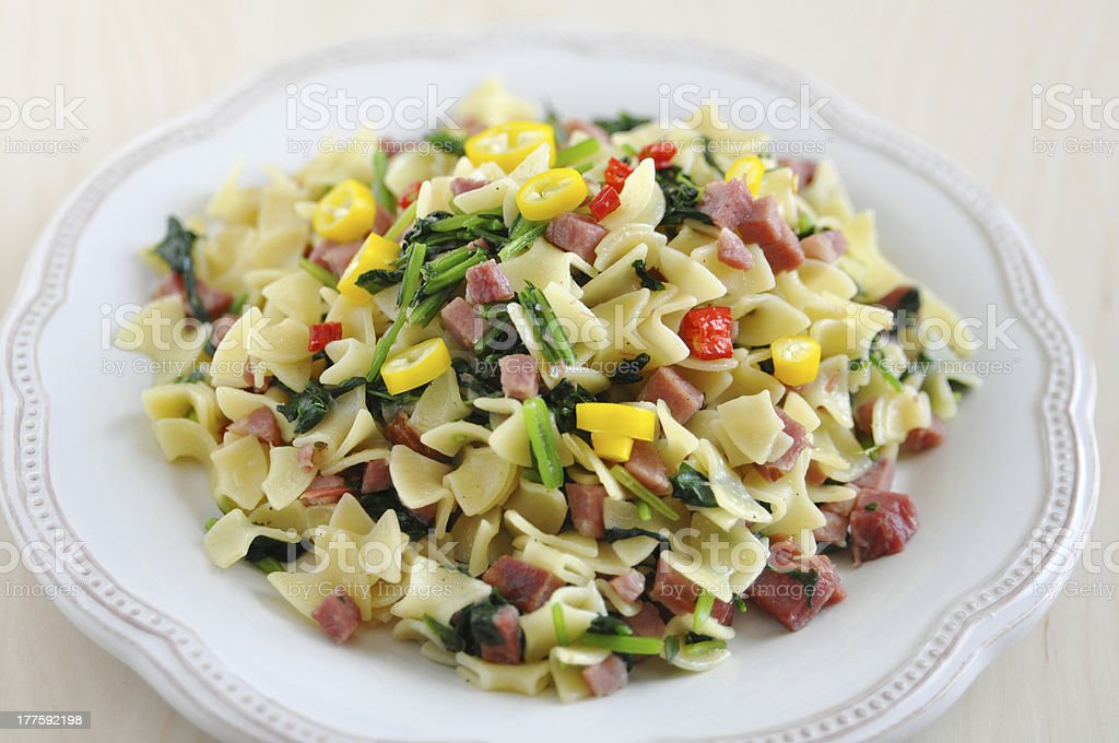 Pasta with bacon and vegetables royalty-free stock photo