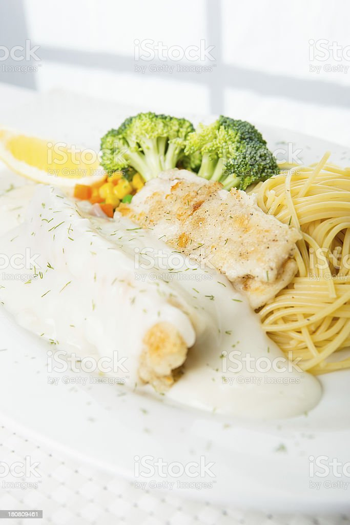 Pasta with baked fillet and vegetable royalty-free stock photo