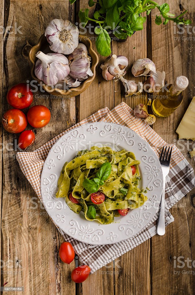 Pasta with basil pesto stock photo