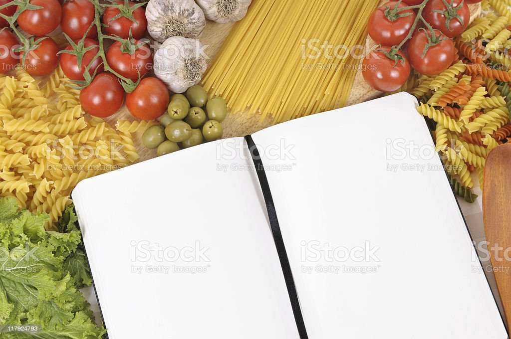 Pasta with blank recipe book and chopping board stock photo