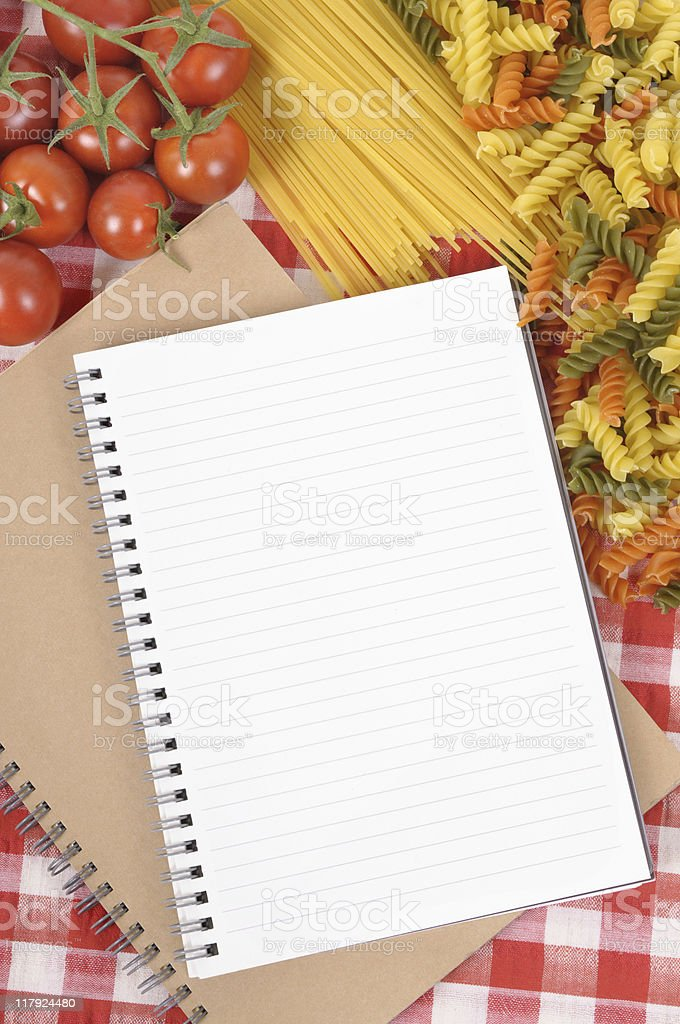 Pasta with blank recipe book and red check tablecloth royalty-free stock photo