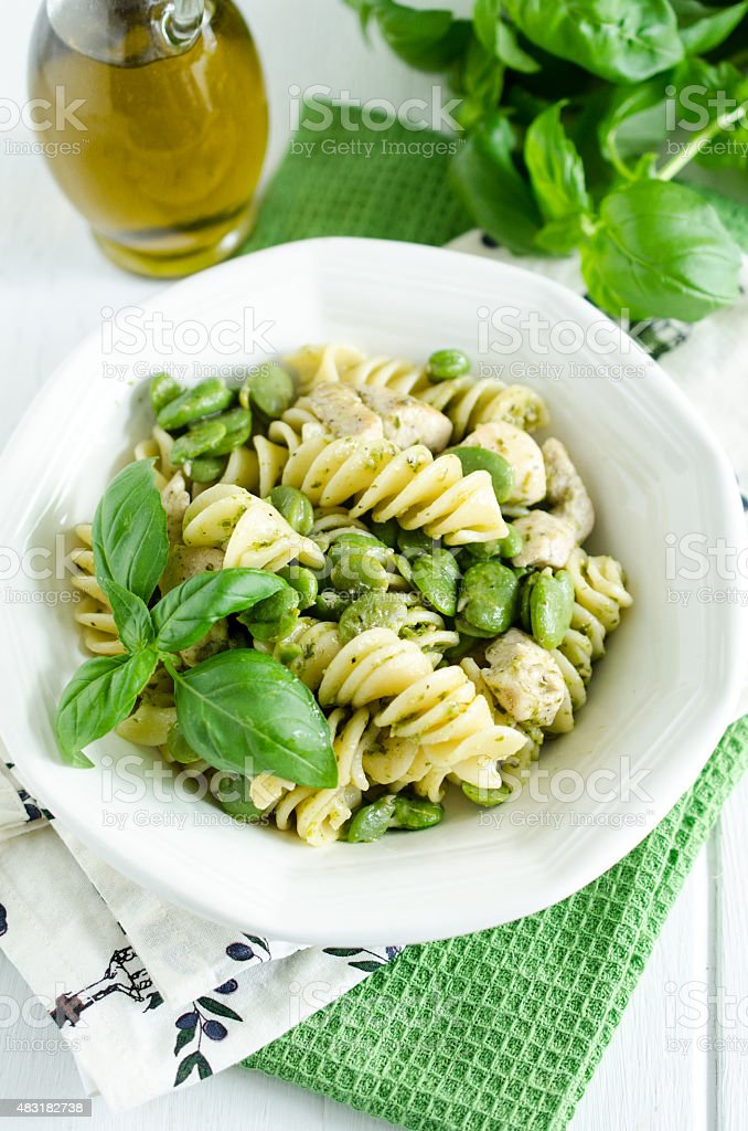 Pasta with broad bean, chicken and pesto genovese stock photo