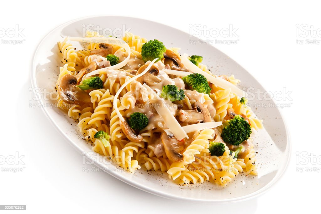 Pasta with broccoli, parmesan and champignons stock photo