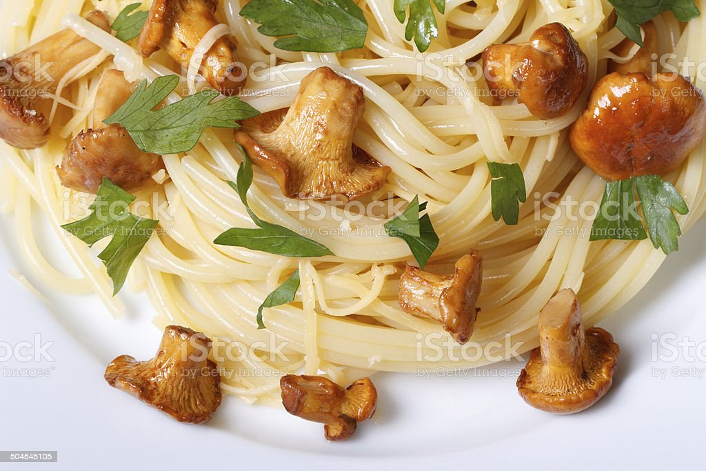 pasta with chanterelle mushrooms on a plate close-up stock photo